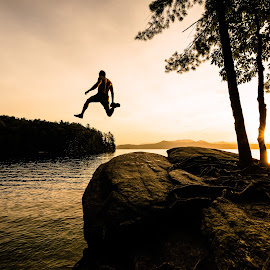 Morning Leap by Tom Moors - Sports & Fitness Fitness ( lake jocassee, lake, sunrise, south carolina, swimming, leap, jump )