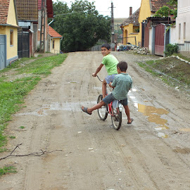 on the road by Liviu Nanu - Transportation Bicycles ( children, road, bicycle )
