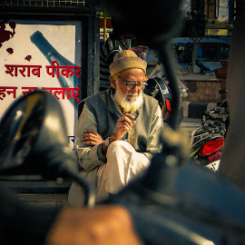 Old man on a busy street in india by Karin Wollina - People Portraits of Men ( street, busy, india, quiet, man,  )