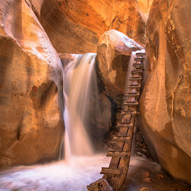 Slot Canyon Waterfall by Juan De Leon - Landscapes Waterscapes ( ladder, water, stream, waterfall, canyon, hiking, kanarra, slot canyon, red, utah, creek, trail, fall, kanarraville, slot, rocks, river )