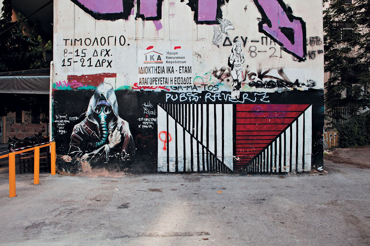 """This image of a gas mask – a symbol of resistance – was sprayed on a wall in Exarcheia after authorities tried to quell violent demonstrations with teargas and batons. The """"anarchist"""" district has long been a haunt of artists and leftist intellectuals, becoming a locus for anti-government sentiment after tanks rolled into a 1973 student sit-in against the country's military dictatorship, killing at least 24 people. The crisis has imbued its streets with new anger and energy."""