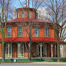 Octagon House by Marsha Biller - Buildings & Architecture Homes ( brick, trees, octagon shape, house, large porch )