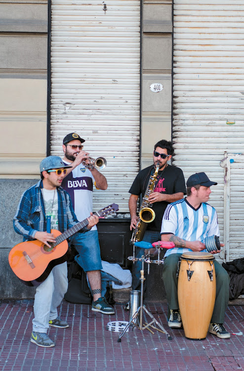 Music spills out onto BA's streets with lively bands and buskers