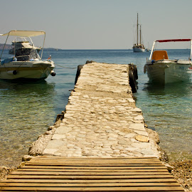 Pontoon symmetry by Alina Dragan - Landscapes Beaches ( natural light, boats, seaside, beach, landscape )