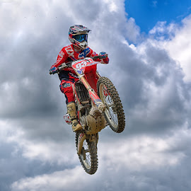 Red 933 by Marco Bertamé - Sports & Fitness Motorsports ( clouds, jumpu, speed, 933, number, race, noise, flying, red, motocross, blue, cloudy, grey, air, high )