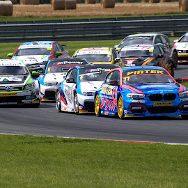 Lap One by Gareth Dickin - Sports & Fitness Motorsports ( corner, green, cars, track, race )