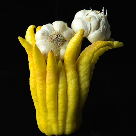 Garlic in hand by Jim Downey - Food & Drink Fruits & Vegetables ( buddha hand lemon, garlic, white, yellow, black )