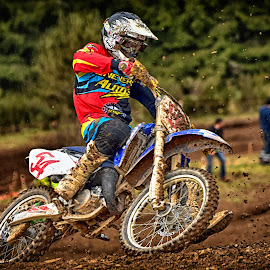 Clump Shower ! by Marco Bertamé - Sports & Fitness Motorsports ( curve, trun, red, motocross, blue, speed, clumps, number, 54, race, accelerating, noise )
