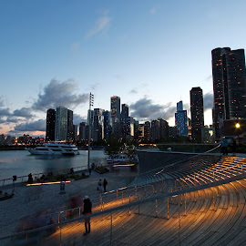 Navy Pier skyline by Dipali S - City,  Street & Park  Skylines ( skyline, illinois, america, skyscrapers, cityscape, travel, architecture, usa, attraction, city, sky, pier, chicago, downtown, water, highrise, building, lake, photo, urban, michigan, landmark, tower, blue, contemporary, cloud, fireworks, night, navy, waterfront, panoramic )