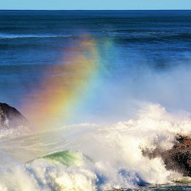 Rainbow in the mist by Lori Pagel - Landscapes Beaches ( water, orange, colorful, green, colors, waves, rocky, ocean, rock, yellow, beach, coastal, coast, shadows, beaches, red, sky, nature, color, blue, shadow, outdoors, wet, rocks, rainbow, foam )