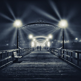 Walking Towards The Light by Garry Dosa - City,  Street & Park  Night ( lights, pier, silhouettes, night, people, darkness, evening, etheral )