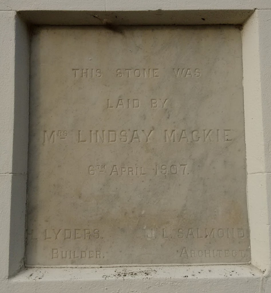 On left side of door to Burns Hall, Dunedin. On right side of the door is plaque laid by Miss BurnsTranscription:This stone was laid by Mrs Lindsay Mackie 6th April 1907H. Lyders BuilderJ. L. Salmond ...