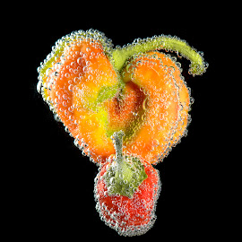 Orange/green/red peppers by Jim Downey - Food & Drink Fruits & Vegetables ( red pepper, orange/green pepper, wet, close up, black )