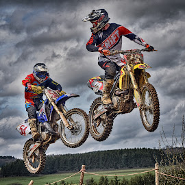 Kiss Me ! by Marco Bertamé - Sports & Fitness Motorsports ( clouds, speed, number, yellow, race, noise, jump, 12, two, flying, red, sky, motocross, blue, air, 54, duel,  )