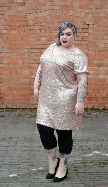 woman in gold sequin dress