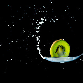 White and green  by Lisa Wilson - Food & Drink Fruits & Vegetables ( splash, kiwi, milk, drops, spoon )