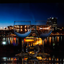 Down on the River Front by Lisa Hendrix - Artistic Objects Other Objects ( lights, reflection, color, apple, artistic, glass, city lights, night, river front, wine glasses, night sky, city, river )