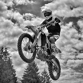 Easy Flight by Marco Bertamé - Black & White Sports ( clouds, 98, flying, motocross, speed, cloudy, air, number, high, race, noise, jump )