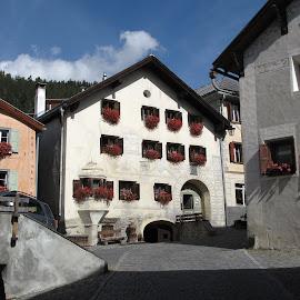 Unterengandin, Guarda, Graubünden, Switzerland by Serguei Ouklonski - Buildings & Architecture Public & Historical ( sky, geranium, street, buildings, historical, village, windows, building, architecture )