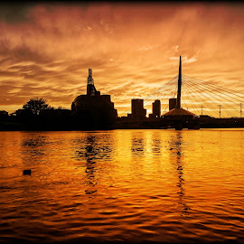 After The Storm by Paul Stadnyk - Landscapes Sunsets & Sunrises ( water, clouds, sunset, yellow, bridge )