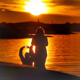 Great November evening in Torslanda Gothenburg 🇸🇪 by Eva Larsson - People Street & Candids ( love sunset boy mother sea reflection )