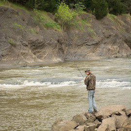 Man Fishing From Rocks by Eva Ryan - People Street & Candids ( hill, oklahoma, male, lake wister, fishing, rocks, man, river,  )