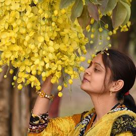 Arti in yellow dress & yellow flower by Basant Malviya - People Portraits of Women ( dress, portraits of women, yellow, arti, flower,  )