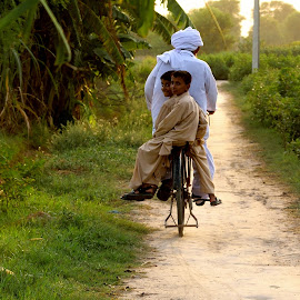 Going back Home by Tahir Sultan - People Street & Candids ( nikon, punjab, candid, sunset, pakistan, cycling, tradition, village, cycle,  )