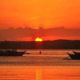 Sunset at Kwebang Lampas, Quezon, Philippines by Say Bernardo - Landscapes Sunsets & Sunrises ( orange, silhouette, quezon, sunset, kwebang lampas, boat, philippines, man )