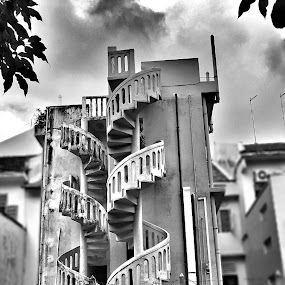 Spiral staircases by Wan Loy Yeong - Black & White Buildings & Architecture ( clouds, houses, black and white, staircase, chinatown, spiral, singapore, back lane, gloomy,  )