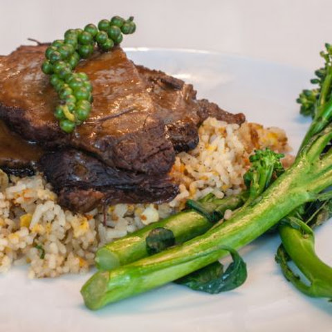 Healthy Broccoli Beef With A Pea Stem Garnish & Fried Rice