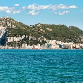 The rock of Gibraltar by Deyan Georgiev - Landscapes Travel ( port, mountain, europe, rock, seaside, travel, coastline, landscape, coast, attraction, spain, city, sky, nature, mediterranean, above, place, water, gibraltar, british, sea, tourism, the rock, landmark, bay, blue, outdoor, view, high )