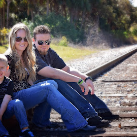 on the rail by Annette Gregory - People Family ( rail road, family )