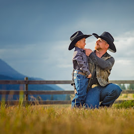 Father and son by Onno Kok - People Family ( cowboy, western, nostalgic, cute, rustic, portrait, hat, country )