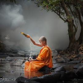 Asia novice monk in the river. by Visoot Uthairam - People Professional People ( calm, face, monk, old, god, oriental, thailand, buddhist, thai, architecture, travel, wat, asian, religion, bangkok, buddhism, ancient, sky, spiritual, cambodian, asia, spirituality, gold, east, alone, cambodia, novice, symbol, decoration, faith, male, bald, tourism, vacations, sacred, worship, buddha, temple, sculpture, statue, stand, color, peace, monastery, meditate, boy, culture )