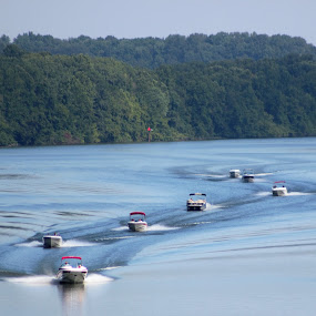 Boats on the river by Karen Beasley - Transportation Boats