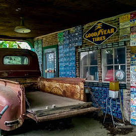 Parked HIstory by Debbie Bates - Transportation Automobiles ( history, gas station, license plates, antique, old truck,  )