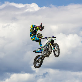 Scorpion by Angela Skinner - Sports & Fitness Motorsports ( clouds, canada, jumping, motorbike, color, blue, motorcycle, air, yellow,  )