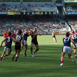 Way up in the air by Paul Sarchuk - Sports & Fitness Australian rules football
