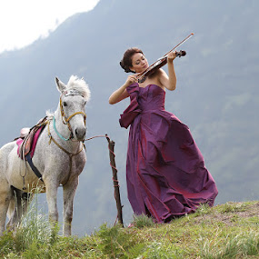 Violist and Her Horse by Endra Martini - People Musicians & Entertainers