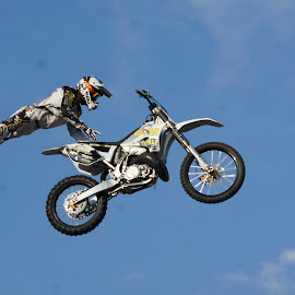 motor cycle jumps by Claude Huguenin - Sports & Fitness Motorsports ( acro, motorcycle, dangerous, circus, jump )