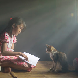 How to train your cat by Indrawaty Arifin - Babies & Children Child Portraits ( training, reading, cat, girl )