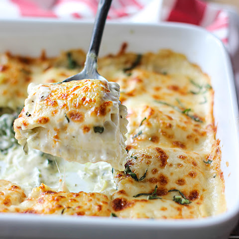 Delicious Ravioli Bake With Spinach And Artichoke