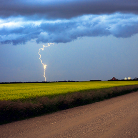 Stormy skies by Janet Gilmour-Baker - Landscapes Weather ( lightning, farms, farmers field, saskatchewan, weather, storms, landscapes, stormy skies, rural, skies,  )