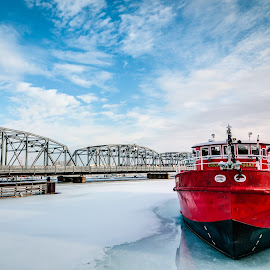 Sturgeon Bay Bridge and Fire Boat by Jebark Fineartphotography - Buildings & Architecture Bridges & Suspended Structures ( water, marine, clouds, sky, winter, bay, ice, snow, architecture, bridge, boat, maritime )