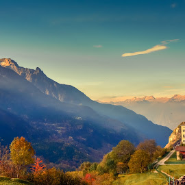 Soglio atmosphere by Haim Rosenfeld - Landscapes Mountains & Hills ( exposure, dreamy, europe, mountain, beauty, yellow, landscape, swiss, sky, nature, tree, cold, autumn, switzerland, nikon, place, light, foreground, soglio, church, colors, green, beautiful, mood, image, atmosphere, forest, scenic, morning, photo, picture, season, color, blue, background, outdoor, trees, moody, view, natural )