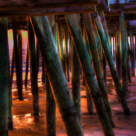 Golden Hour Under The Pier  by Chris Cavallo - Buildings & Architecture Bridges & Suspended Structures ( maine, atlantic ocean, pier, sea, ocean, sunrise, beach, ocean view, golden hour )