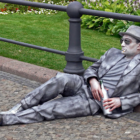 Pretending Statue by Leif Holmberg - People Portraits of Men ( vine, vino, living statue, gray, berlin germany )