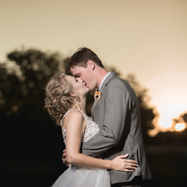 Kiss by Lood Goosen (LWG Photo) - Wedding Bride & Groom ( bride, love, wedding dress, couple, groom, wedding photographer, wedding photography, wedding couple, bride groom, weddings, wedding day, wedding photographers, brides, kiss, bride and groom, sunset, wedding )