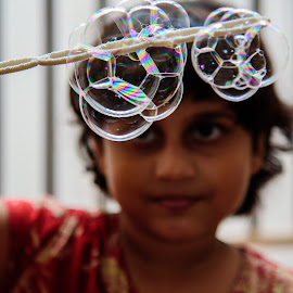 Bubble maker by Mahul Mukherjee - Babies & Children Children Candids ( child, bubble, girl, head shot, play, enjoy, game, close up )